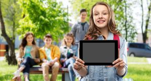 Student girl with school bag and tablet computer royalty free stock photography