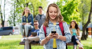 Teen student girl with school bag and smartphone royalty free stock photos