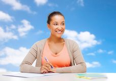 African american student girl with notebook stock image