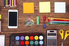 Education, school supplies, close up of stationery and smartphon Stock Photo