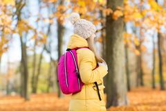 Student girl with school bag at autumn park. Education and season concept - teenage student girl with school bag at autumn park stock images
