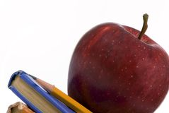 Education Series (Apple on books macro angled) Stock Images
