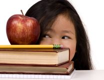 Education Series (looking at the apple) Royalty Free Stock Photo