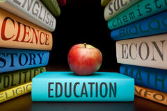 Education study books high school or university. Education study books with text learning building knowledge at high school or university with healthy apple