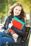 Education and study. happy female student. Girl with note books and workbooks in park outdoors Stock Photo