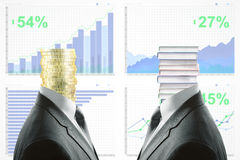 Education and success concept. Golden coin and book pile headed businesspeople in suits on business chart background. Education and success concept Stock Photo