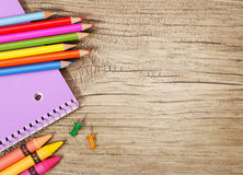 Education supplies on old wooden background. Colorful pencils Stock Images