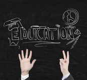 Education symbols on blackboard Stock Images