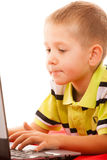 Education, technology internet - little boy with laptop Royalty Free Stock Image