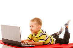 Education, technology internet - little boy with laptop Stock Photos