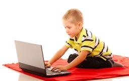 Education, technology internet - little boy with laptop Stock Photo