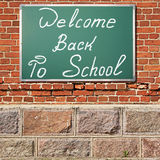 Education theme. Ancient brick wall with Welcom back to school t stock photography