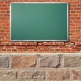 Education theme. Chalkboard with copy space on ancient wall royalty free stock photography