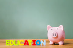 Education theme with and piggy bank Stock Photography