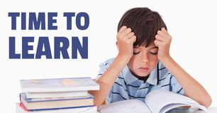 Education and time to learn text and frustrated boy reading a book Stock Image