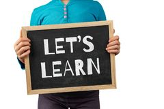 The topic of education depicted with child hands. Education topic depicted with child holding blackboard with text Let`s Learn stock photos