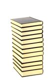 Education tower. Bronze books tower isolated on white background stock photo