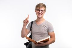 Education, university, idea and people concept - student with book showing finger up on white background. Education, university, idea and people concept royalty free stock image