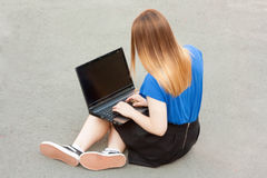 Education using gadget concept. Girl with laptop Royalty Free Stock Photo