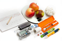 Education about what you need to control diabetes: insulin pump, blood sugar meter, insulin pen, glucagon injection adrenalin, s Stock Photography