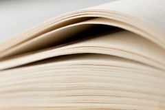 Education and wisdom concept - Macro view of book pages. Education and wisdom concept- Macro view of book pages royalty free stock images