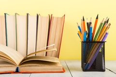 education and wisdom concept - open book on wooden table, color background royalty free stock photo
