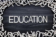 Education wooden letters on black board royalty free stock photography