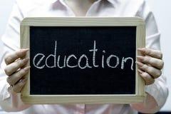 Education word written on blackboard/chalckboard Stock Image
