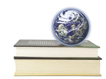 Education in the World. This image shows the Earth is set on some books Royalty Free Stock Photo