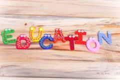 EDUCATION WRITTEN WITH BLOCK LETTERS ON WOODEN TABLE stock photo