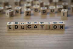 Education written in wooden cubes royalty free stock photo
