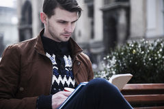 Education. Young male student preparing for exams. Self-development, learning, success concept Stock Photos