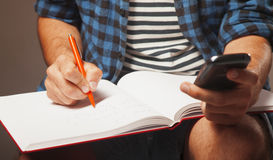 Education. Young male student preparing for exams. Royalty Free Stock Photo