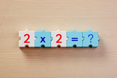 Educational blocks with math problems on the table Royalty Free Stock Photos