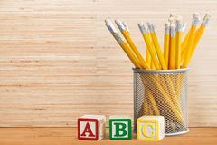 Educational blocks and pencils Stock Photo