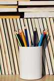Educational books and pencils Stock Photos