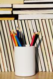 Educational books and pencils, vertivally oriented Stock Photography