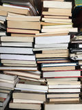 Educational books piled on table Royalty Free Stock Images