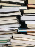 Educational books piled on table Royalty Free Stock Image