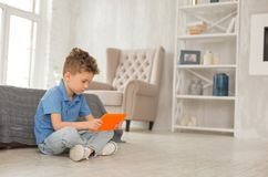 Little smart boy watching educational cartoon Stock Photography