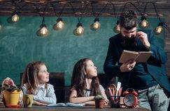 Educational concept - schoolchildren in a classroom. Enrichment classes can be difficult for some kids so tutors are. Best. Final exam test in university stock photos