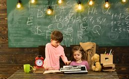 Educational concept - schoolchildren in a classroom. Enrichment classes can be difficult for some kids so tutors are stock photo