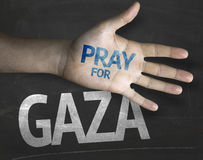 Educational and Creative composition with the message Pray for Gaza on the blackboard Royalty Free Stock Photography