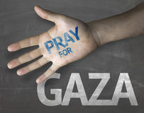 Educational and Creative composition with the message Pray for Gaza on the blackboard Stock Image