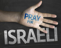 Educational and Creative composition with the message Pray for Israeli on the blackboard.  Royalty Free Stock Photos