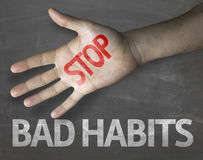 Educational and Creative composition with the message Stop Bad Habits on the blackboard Stock Images