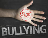 Educational and Creative composition with the message Stop Bullying on the blackboard Royalty Free Stock Images