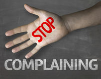 Educational and Creative composition with the message Stop Complaining on the blackboard Royalty Free Stock Photography