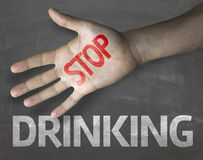 Educational and Creative composition with the message Stop Drinking on the blackboard Royalty Free Stock Photography