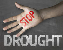 Educational and Creative composition with the message Stop Drought on the blackboard Royalty Free Stock Images